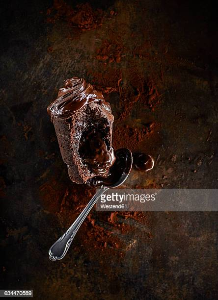 Chocolate muffin with liquid core, cocoa and tea spoon
