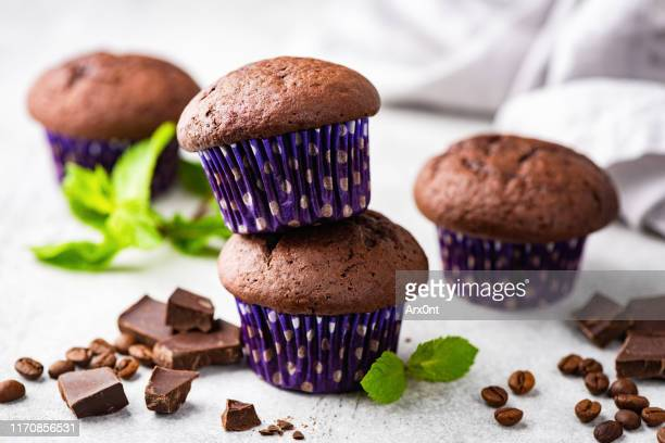 chocolate muffins with purple polka dot muffin cups - temptation stock pictures, royalty-free photos & images