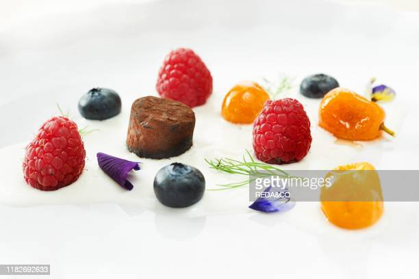 Chocolate on almond cream with fresh fruits