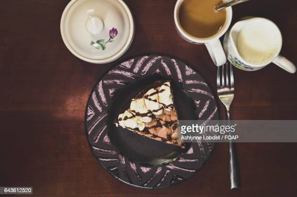 Chocolate pie and coffee with cream