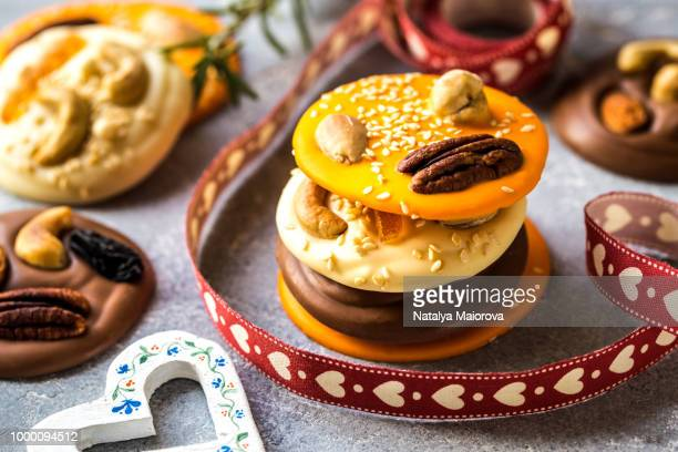 chocolate pieces, candies, sweets with nuts, candied citrus and spices