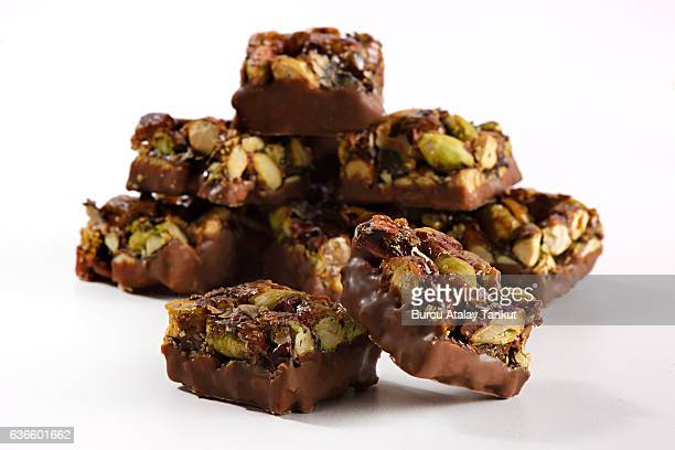 chocolate pieces with pistachios - chocolate pieces stock photos and pictures