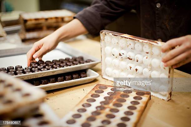 chocolate production - chocolate factory stock photos and pictures