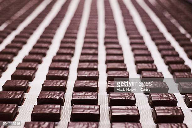 Chocolate products on a conveyor belt in a factory on June 19 2016 in Vinnytsia Ukraine Roshen Confectionery Corporation is a Ukrainian confectionery...