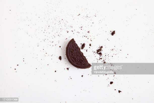 chocolate sandwich cookie.  half a broken cookie - part of stock pictures, royalty-free photos & images