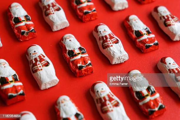 chocolate santa and snowmen sweets - chocolate stock pictures, royalty-free photos & images