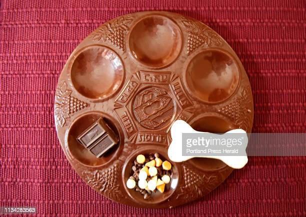 A chocolate Seder plate with unsweetened dark chocolate left to serve as the moror symbolic of the bitterness of enslavement a variety of chocolate...