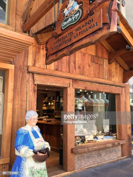 chocolate selling store, bariloche, argentina - bariloche stock pictures, royalty-free photos & images