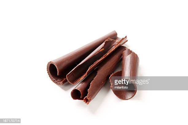 Chocolate shavings laying on a white background