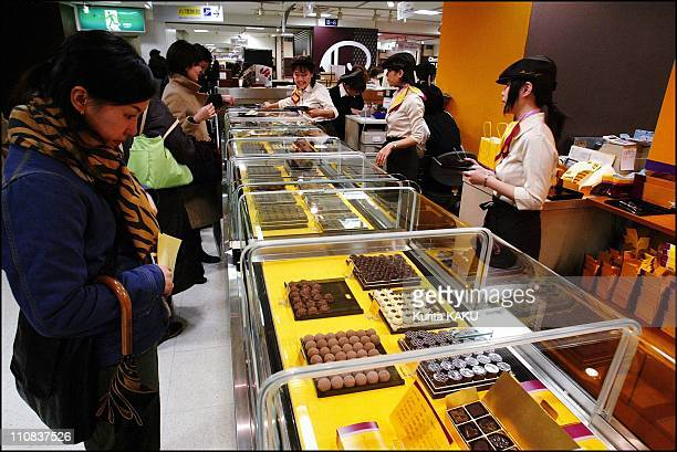 Chocolate Show At Isetan Department Store In Tokyo Japan On February 02 2004 Japanese women looks chocolates at Chocolate show at Isetan department...