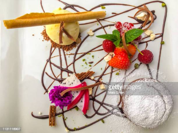 chocolate souffle cake - dessert topping stock pictures, royalty-free photos & images