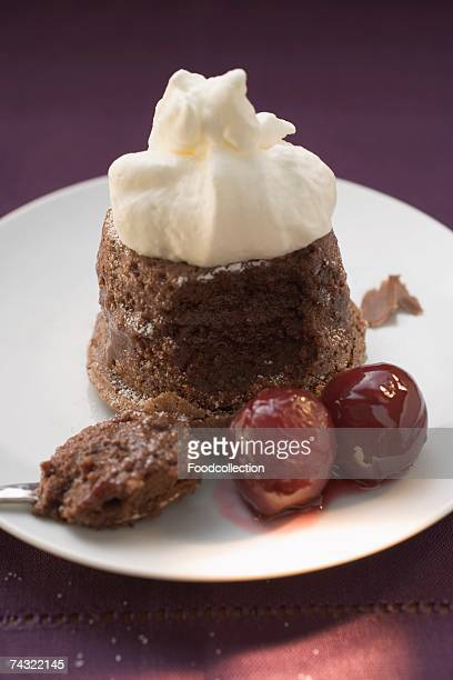 Chocolate souffle with cream and cherries