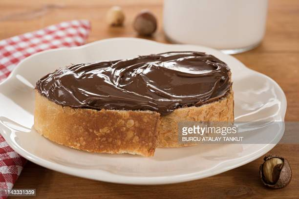 chocolate spread on bread - nutella stock pictures, royalty-free photos & images