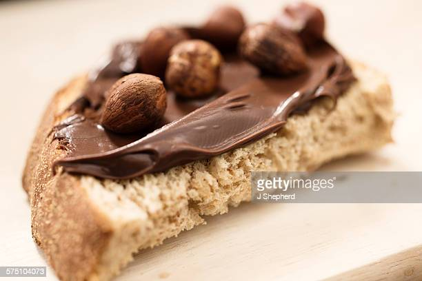 Chocolate spread with hazelnuts on bread