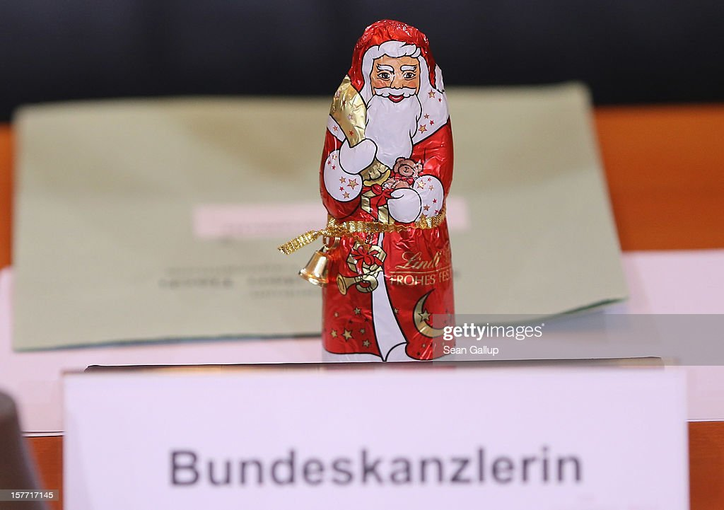 A chocolate St. Nicholas stands at the place of German Chancellor Angela Merkel prior to the weekly German government cabinet meeting on December 6, 2012 in Berlin, Germany. Merkel is scheduled to meet with Israeli Prime Minister Benjamin Netanyahu later today.