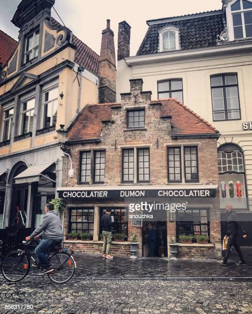 chocolate store in bruges, belgium - chocolate shop stock pictures, royalty-free photos & images