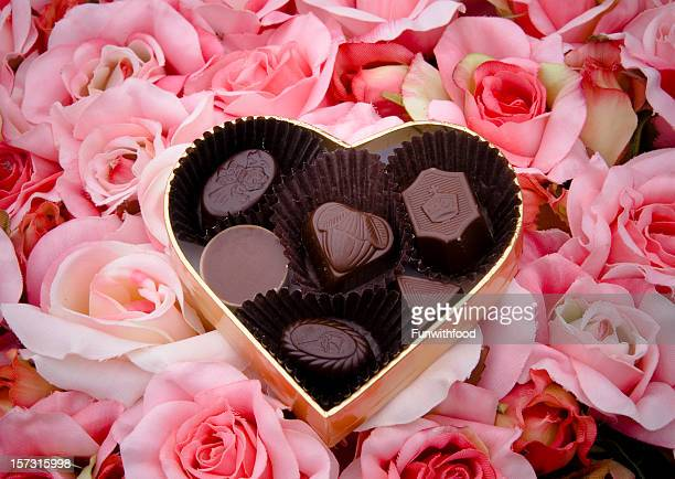 chocolate truffles, valentine's day candy, heart shape gift box & roses - box of chocolate stock pictures, royalty-free photos & images