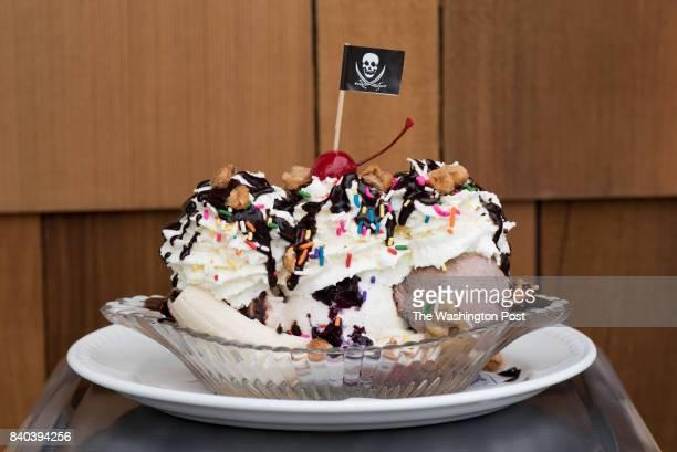 Chocolate, vanilla, and strawberry ice cream, hot fudge, caramel, berry sauce, roasted peanuts & jimmies at Salt LIne.