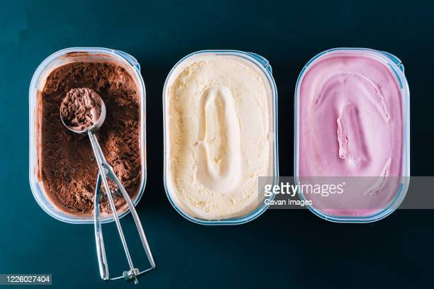chocolate, vanilla and strawberry ice cream tubs with scoop - frozen stock pictures, royalty-free photos & images