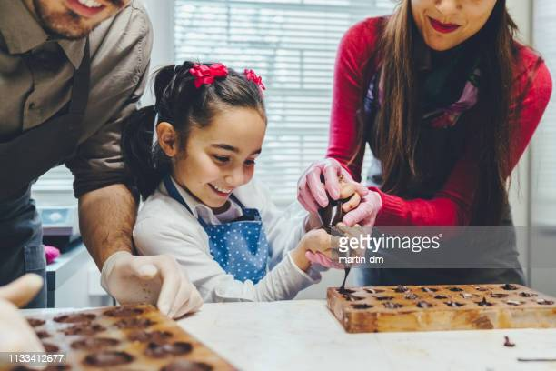 chocolate workshop - chocolate making stock pictures, royalty-free photos & images