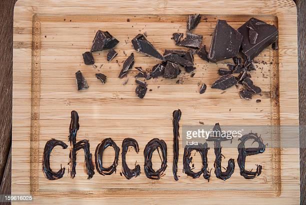 Chocolate written on cutting board