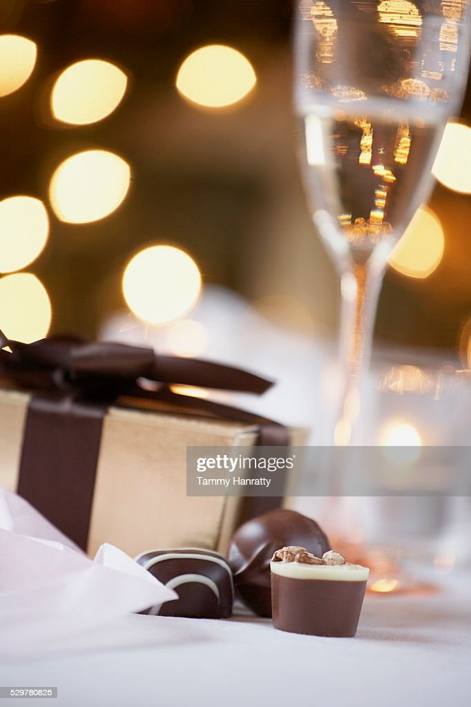 Chocolates and Wrapped Gift : Stock Photo
