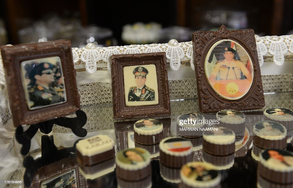 Chocolates decorated with portraits of Egypt's army chief General Abdel Fattah al-Sisi are displayed at a shop in Cairo on August 27, 2013. Egyptian Bahria Galal, the owner of the shop, attributed her idea to make 'Sisi chocolates out of her love and respect to the man who, according to her, saved her country from the regime of Islamist president Mohamed Morsi. Sisi became a national icon after the army evicted democratic elected Morsi from office after a nationwide protests against him.