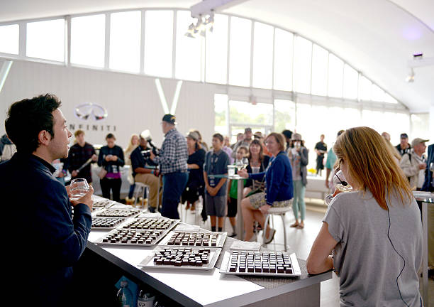 Chocolatier Jonathan Grahm (L) and master sommelier Andrea Robinson speak  during day 4 of