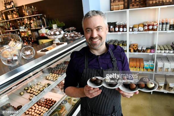 Chocolatier Phil Simonson shows off some of his unique truffles that are all made by hand at Chocolate Lab on February 7 2018 in Denver Colorado...