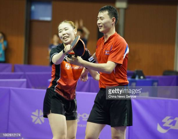 Choe Ii of North Korea and Yoo Eunchong of South Korea celebrate their victory in the Mixed Doubles preliminary first round match against Alvaro...