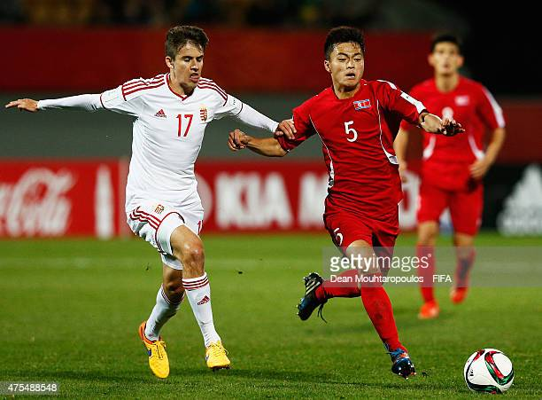 Choe Ju Song of Korea DPR and Adam Nagy of Hungary battle for the ball during the FIFA U20 World Cup New Zealand 2015 Group E match between Korea DPR...