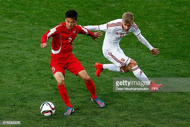 Choe Ju Song of Korea DPR and Mario Nemeth of Hungary battle for the ball during the FIFA U20 World Cup New Zealand 2015 Group E match between Korea...