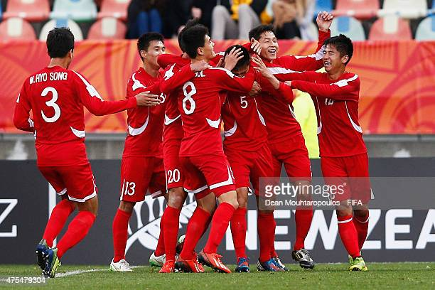 Choe Ju Song of Korea DPR celebrates with team mates after scoring his teams first goal during the FIFA U20 World Cup New Zealand 2015 Group E match...