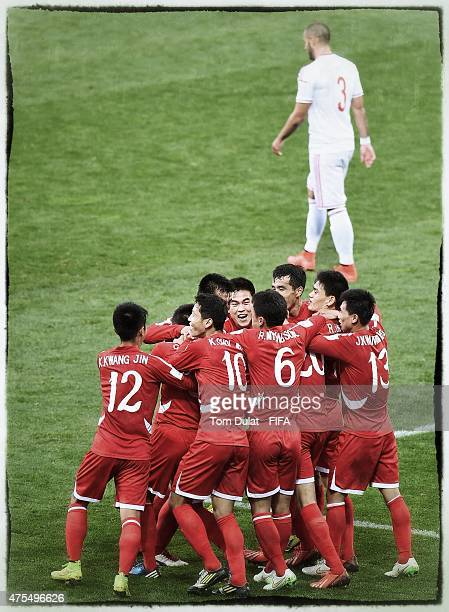 Choe Ju Song of Korea DPR celebrates with the team scoring a goal during the FIFA U20 World Cup New Zealand 2015 Group E match between Korea DPR and...
