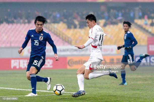 Choe JuSong of North Korea in action against Honoya Shoji of Japan during the AFC U23 Championship China 2018 Group B match between Japan and North...