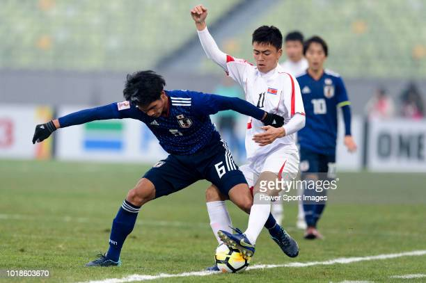 Choe JuSong of North Korea in action against Yoichi Naganuma of Japan during the AFC U23 Championship China 2018 Group B match between Japan and...