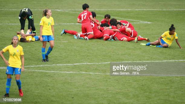 Choe Kum Ok of Korea DPR celebrates her team's second goal with team mates during the FIFA U20 Women's World Cup France 2018 group B match between...