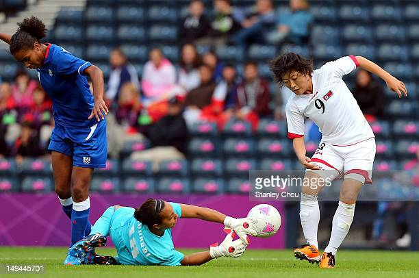 Choe Mi Gyong of DPR Korea in action with Sarah Bouhaddi of France during the Women's Football first round Group G match between France and DPR Korea...