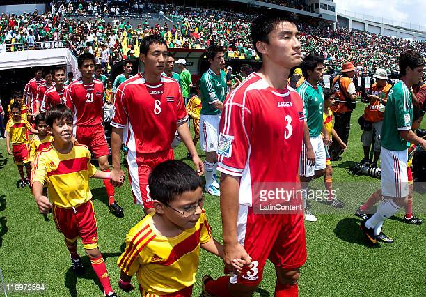 Choe Myong Song Ju Jong Chol and Choe Chol Ryong of North Korea during a match against Mexico as part of the FIFA U17 World Cup Mexico 2011 Group A...