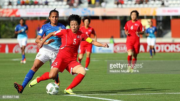 Choe Sol Gyong of Korea DPR shields the ball from Duda of Brazil during the first half of their Group A match of the FIFA U20 Women's World Cup Papua...