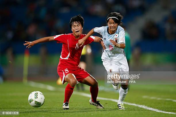 Choe Un Chong of Korea DPR is challenged by Hinata Miyazawa of Japan during the FIFA U-17 Women's World Cup Finale match between Korea DPR and Japan...