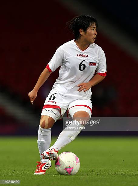 Choe Un Ju of DPR Korea controls the ball during the Women's Football first round Group G Match of the London 2012 Olympic Games between Colombia and...