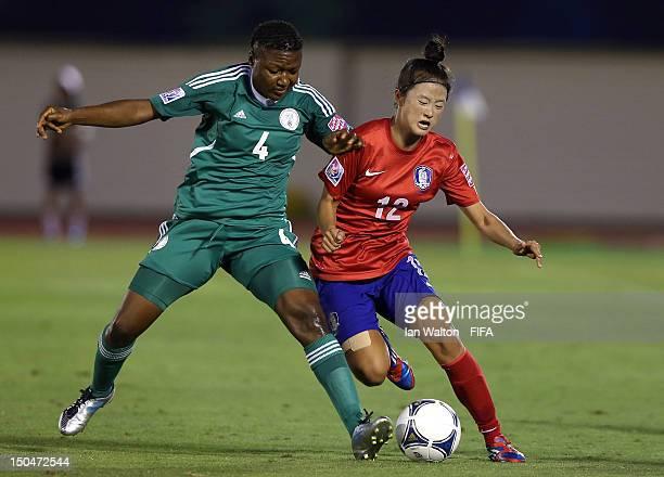 Choe Yuri of Korean Republic is tackled by Ugo Njoku of Nigeria during the FIFA U20 Women's World Cup Japan 2012 Group B match between Nigeria v...