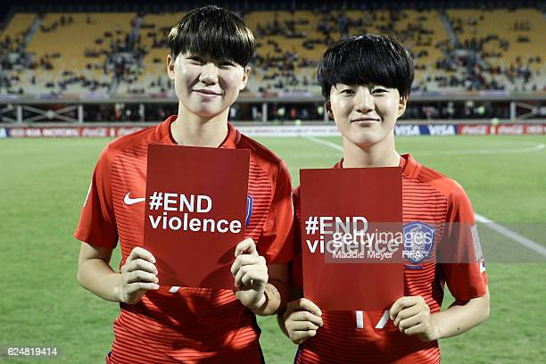 Choi Heejeong of Korea Republic and Lee Sohee stand with red cards to support the #ENDviolence campaign after their Group D match in the FIFA U20...
