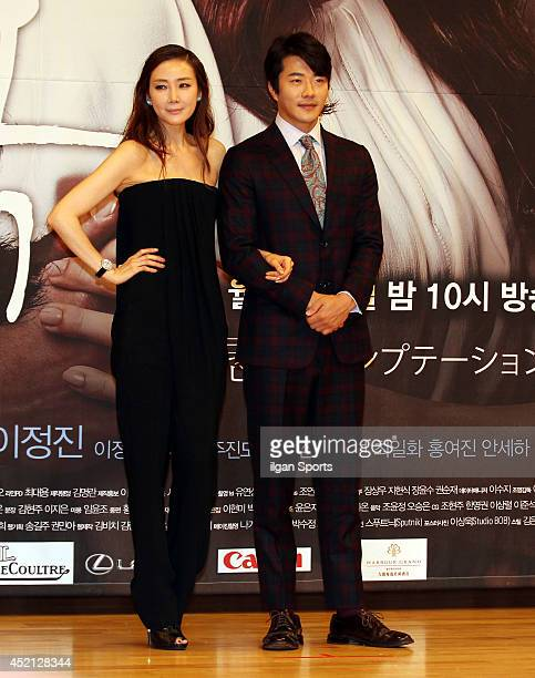 Choi JiWoo and Kwon SangWoo pose for photographs during the SBS drama 'Temptation' press conference at SBS broadcasting center on July 10 2014 in...