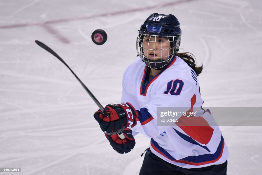TOPSHOT - Choi Ji-yeon of Unified Korea watches the puck during their women's Classifications ice hockey game against Switzerland at the Pyeongchang 2018 Winter Olympic Games at the Kwandong Hockey Centre in Gangneung on February 18, 2018. / AFP PHOTO / Ed JONES