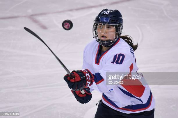 Choi Ji-yeon of Unified Korea watches the puck during their women's Classifications ice hockey game against Switzerland at the Pyeongchang 2018...