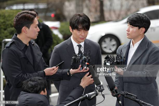 Choi JongHoon aka Jonghoon former member of South Korean boy band FTisland is seen arriving at a Seoul police station for questioning over a sex...