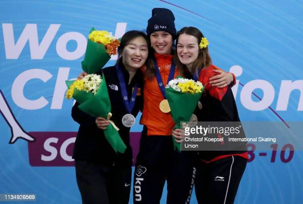 Choi Min Jeong of the Republic of Korea , Suzanne Schulting of Netherlands and Kim Boutin of Canada pose during the medal ceremony of the Ladies...