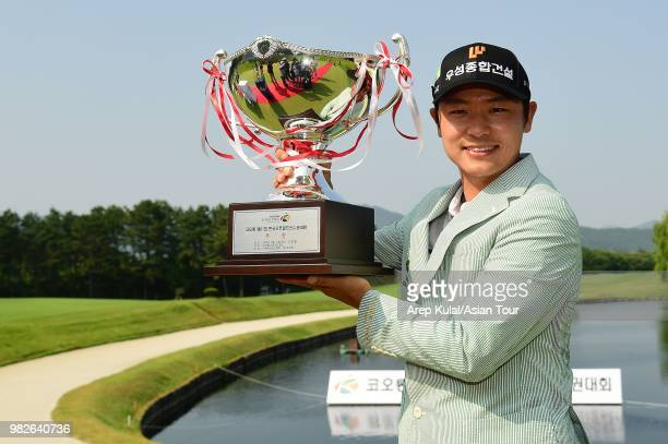 Choi Minchel of South Korea poses with the trophy and VVIP's after winning the Kolon Korea Open Golf Championship at Woo Jeong Hills Country Club on...